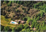On about 6,5 ha of wooded lands with magnificent views, pretty stone house with pool.