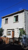 Renovated village house with 4 bedrooms and pleasant garden.