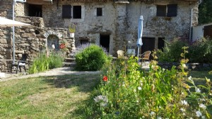 Renovated 17th century mill with main residence, apartment and studio on 1.7 ha with brook.