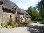 Pretty stone house and cottage with outbuildings