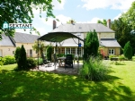 In the heart of a village with amenities between Mortagne au Perche and Le Mele sur Sarthe