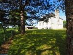 Large, historic residence on a 2 hectare site.