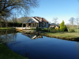Stunningly renovated farmhouse, with 2 hectares of closed parkland and pond.