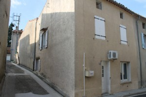 Village house with outside space and garage to renovate, loads of potential.