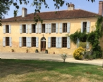 Equestrian property with fine farmhouse,  small vineyard and 21 ha of
