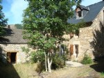 Village house in stone and slate with outbuildings and adjoining land