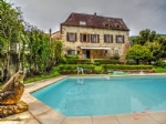 Near St Céré, (Lot) - A former presbytery of the 17th century, restored by an architect, with a pool