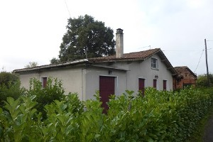 Detached house with approx. 1 acre plus 2nd small house, garage and outbuilding.
