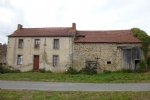 Farmhouse with attached barn and 1.5 hectares of forest.