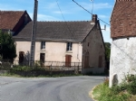 Semi detached village house with a small closed garden