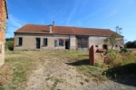 A property (old farm) with 2 houses and outbuildings, land and very sound structure.