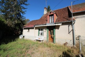 Small cottage with outbuildings in a quiet hamlet.