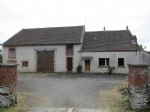 Large detached farm with 9.9 Acres of land and outbuildings.