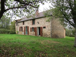 Detached 3 bedroom stone house surrounded by own garden.