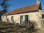 Detached 2-bedroom farmhouse with large barn, stables & Land