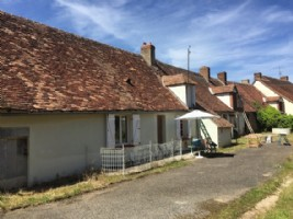 A charming longère with attached buildings and a barn