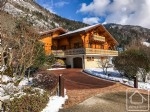 A spacious and modern chalet with swimming pool in a unique and sought after location.