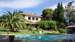 Attractive house on 8000 m² with pool and views, near town centre.
