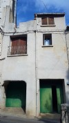 Spacious village house to modernise with terraces, garages and near the river, great potential!