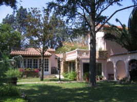 Spacious property with main residence and 2 gites on a 1215 m² with pool and lush gardens.