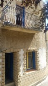 Pretty village house with 45 m² of living space, balcony, cellar and terrace !