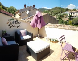 Charming village house, sold furnished, with 100 m² living space, 2 terraces and a garage.