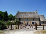 Beautiful thatched stone house with four bedrooms, a double garage, studio and stone barn