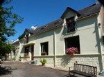 Spacious country house with outbuildings near Baud