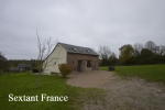 Renovated country cottage, with superb views, set in 1800m² of garden.