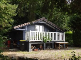 Wooden chalet with beautiful view on wooded land of 745m2