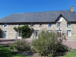 Substantial renovated stone house with attached gite in grounds of over two acres in rural area