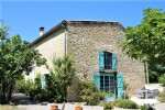 Village property consisting of main house and separate gîte, swimming pool, gardens and views.