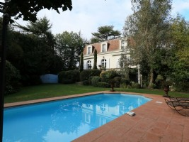 An elegant town house set on the edge of the Adour river