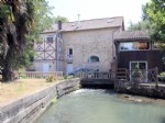 An authentic mill house with an active mill stream.