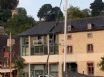 Apartment for sale on the port of dinan - glass facade on the rance and the boat