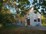 Renovated house with apartment, office and professional garage