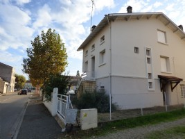 Large city house in the heart of a charming village with shops.