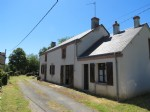 Detached farmhouse with land and 2 large barns