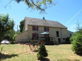 Detached stone 3-bedroom house with garden and outbuildings.