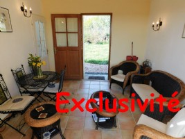 *Village house with roof terrace and garden.