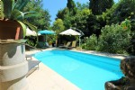 'A home to make the spirits soar!' Six bedrooms, large gardens and pool.