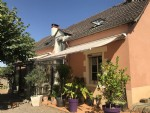 Village house with in-ground swimming pool, garage & land