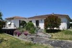 Bungalow in Ruffec with Small Basement, 3 Bedrooms and Garages