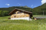 A pristine 5 bedroom, 5 bathroom chalet with double garage and lovely, natural garden.