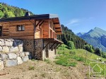 A 4 bedroom / 3 bathroom chalet with terrace and covered parking.