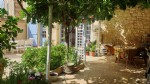 Renovated stone barn with 200 m² of living space, beautiful courtyard, garden and pool.