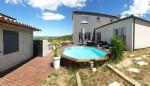 Very nice new villa with 130 m² of living space on 744 m² of land with views and pool.