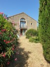 Former distillery converted into an habitation with 240 m² of living space on 900 m² with pool.