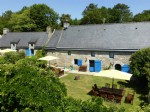 Three stone Breton houses in exceptional country setting.