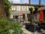 Lovely town house with garden and outbuilding.